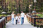 Walking family on the bridge