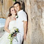 Bride and groom on the beach. Tropical wedding