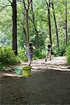 Children running on path through woods