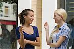 Young women taking cigarette break