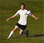USA, Utah, Orem, teenage (14-15) boy playing soccer