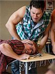 USA, Utah, Young men bullying teenage boy (16-17) in classroom