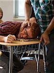USA, Utah, Young man bullying teenage boy (16-17) in classroom