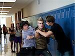 USA, Utah, Spanish Fork, Three boys (16-17) fighting in school corridor