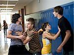 USA, Utah, Spanish Fork, Four school children (16-17) fighting in school corridor