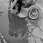 USA, Utah, Salt Lake City, Reflection of couple kissing near scooter