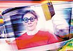 Man smiling, holding credit card, digital composite.