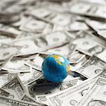 Small world globe on top of U.S. Dollars