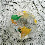 World globe on top of U.S. Dollars