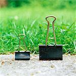 Binder clips on sidewalk