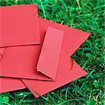 Red envelopes on grass
