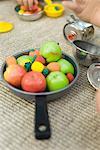 Plastic food in toy pan