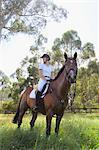 Young Woman Horseback Rider Looking Away