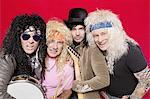 Portrait of four hippie musicians