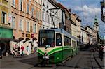 Tram on Herrengasse, with Stadtpfarrkirche (city parish church) in distance, Graz, Styria, Austria, Europe