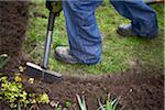 Gardener Edging Garden in Spring, Toronto, Ontario, Canada
