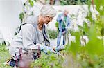 Older couple gardening in backyard