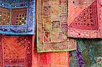 Ornate tapestries hanging together