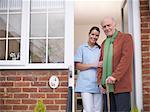 Nurse and older man standing in doorway