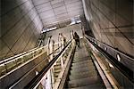 People on escalator in underground station