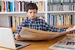 Boy Reading Newspaper