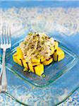 Mango cubes topped with foie gras mousse