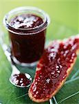 Raspberry jam on a slice of bread
