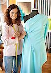 Female dressmaker working on elegant dress