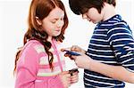 Children looking a smartphones