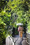 Woman Walking with Parasol at Ryukyu Mura, Onna, Okinawa, Ryukyu Islands, Japan