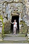 Indonesia, Bali, Goa Gajah temple (elephant cave), entrance, young girl