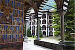 Arcade murals depicting religious figures, Church of the Nativity, Rila Monastery, UNESCO World Heritage Site, nestled in the Rila Mountains, Bulgaria, Europe