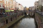 The busy Vismarkt shopping street runs along the Oudegracht canal in Utrecht, Utrecht Province, Netherlands, Europe