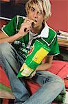 Teenage boy eating crisps