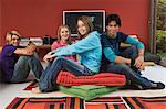 2 teenage girls and 2 teenage boys sitting in living-room