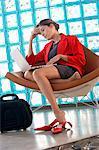 Businesswoman sitting on chair using laptop