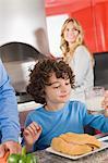 Boy having breakfast in the kitchen