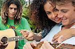 Woman embracing a man playing ukulele