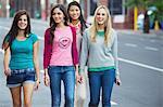 Portrait of beautiful women walking on the road