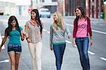 Beautiful women walking on the road