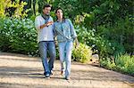 Happy mature couple walking in a garden