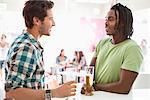 Friends having beer at a bar