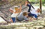 Little children falling down from hammock