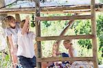 Siblings playing in tree house