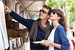Couple choosing books at a book stall, Paris, Ile-de-France, France