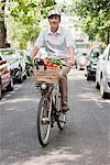 Man carrying vegetables on a bicycle, Paris, Ile-de-France, France