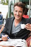 Man drinking coffee in a restaurant, Paris, Ile-de-France, France