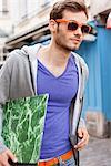 Man carrying a file, Paris, Ile-de-France, France