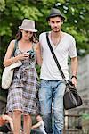 Couple walking on a road, Paris, Ile-de-France, France