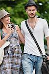 Couple walking on a road and smiling, Paris, Ile-de-France, France